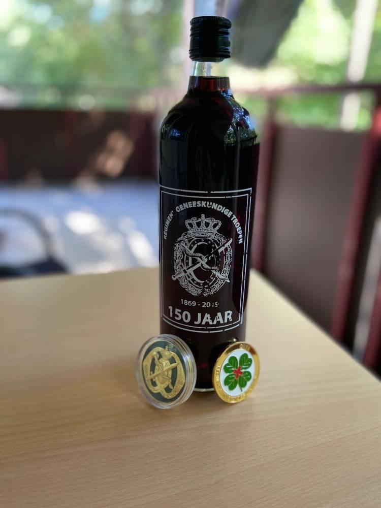 De fles Akkefietje met de UitzendCoin